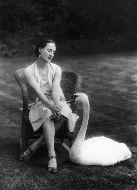 Anna Pavlova in the garden of Ivy House with her favourite pet swan, Jack