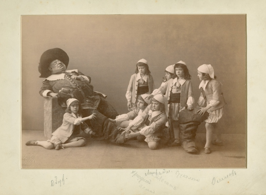 Alexei Bulgakov as the Ogre with Students of the Imperial Ballet School Mikhail Obukhov, Christian Kristerson, Ivan Aslin, Sergei Legat, Leonid Mikhailov, Vassily Stukolkin and Sergei Osipov as Hop 'o' My Thumb and his brothers (1890)