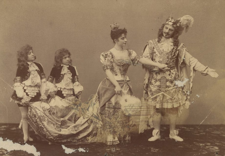 Carlotta Brianza as Princess Aurora and Pavel Gerdt as Prince Desire with two students as pages (1890)